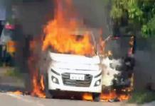 car with three people was set on fire in Vijayawada